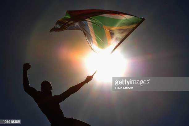 A fan waves a South African flag during the Bafana Bafana parade on June 9 2010 in Sandton South Africa