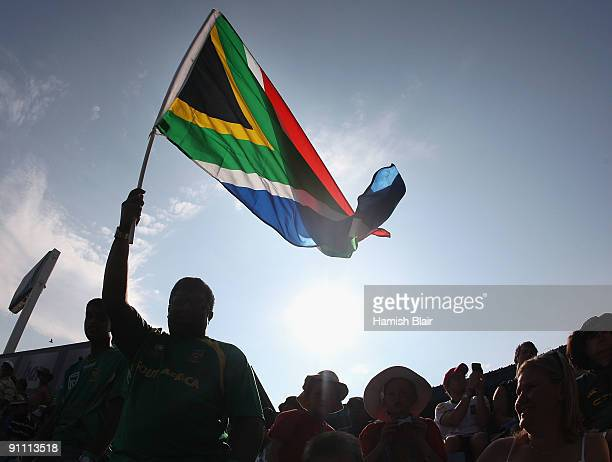 A fan waves a South African flag during the ICC Champions Trophy Group B match between South Africa and New Zealand on September 24 2009 in Centurion...