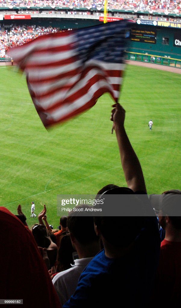A fan waves an American flag at RFK stadium during the July 4th game between the Washington Nationals and the Chicago Cubs. The Nationals beat the cubs 6-0 with two home runs including a grand slam.
