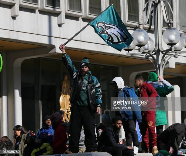 A fan waves an Eagles flag during the Philadelphia Eagles Super Bowl Victory Parade on February 8 2018 in Philadelphia Pennsylvania