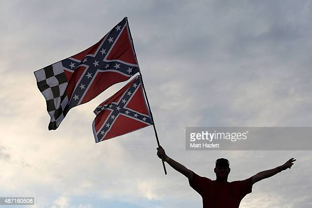 Fan waves Confederate flags from the infield during the NASCAR Sprint Cup Series Bojangles' Southern 500 at Darlington Raceway on September 6, 2015...