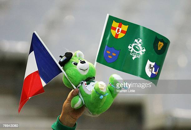 A fan waves flags of the opposing teams during the Rugby World Cup 2007 Pool D match between France and Ireland at the Stade de France on September...
