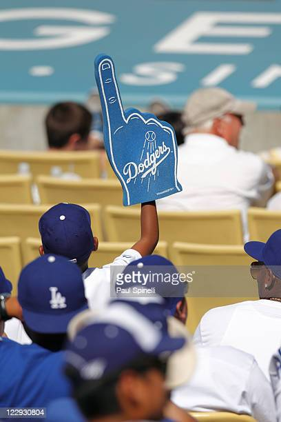 A fan waves his foam finger during the Los Angeles Dodgers game against the Washington Nationals at Dodger Stadium on Sunday July 24 2011 in Los...