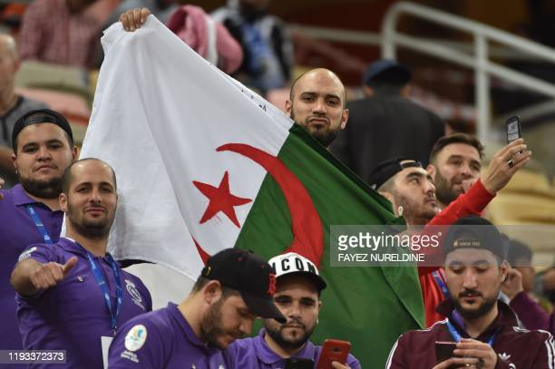 Fan waves the Algerian national flag ahead of the Spanish Super Cup final between Real Madrid and Atletico Madrid on January 12 at the King Abdullah...