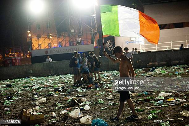 A fan waves the Italian flag as he leaves the arena of the Circus Maximus after the UEFA EURO 2012 final match between Italy and Spain on July 1 2012...