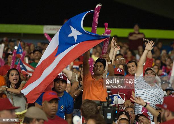 A fan waves the national flag of Puerto Rico in the stands during action against Dominican Republic in the Pool C Game 6 of the first round of the...