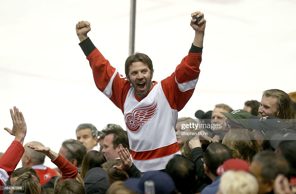 A fan wearing a Detroit Red Wings celebrates after catching a puck that flew into the stands in the game with the Anaheim Ducks at Honda Center on February 23, 2015 in Anaheim, California. The Ducks won 4-3 in a shootout.