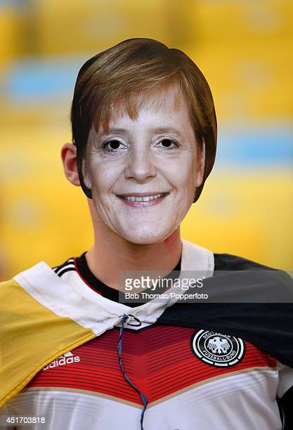 A fan wearing a face mask of German Chancellor Angela Merkel prior to the 2014 FIFA World Cup Brazil Quarter Final match between France and Germany...