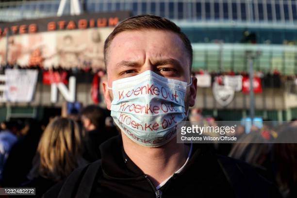 Fan wearing a face mask with Kroenke Out written across it ahead of the Premier League match between Arsenal and Everton at Emirates Stadium on April...