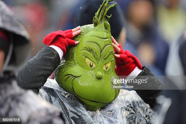 A fan wearing a grinch's mask during the game The New York Jets played the New England Patriots at Gillette Stadium in Foxborough Mass Dec 24 2016