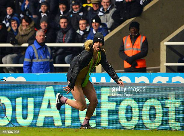 A fan wearing a 'Mankini' runs onto the pitch during the Barclays Premier League match between Newcastle United and Manchester City at St James' Park...