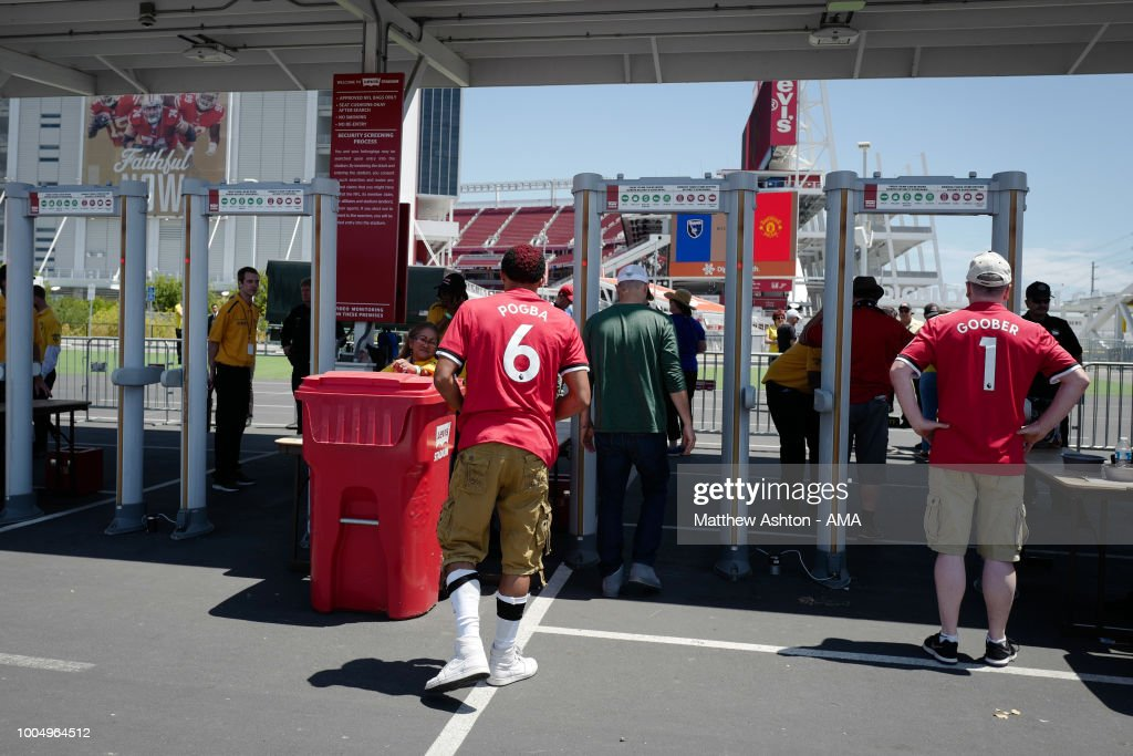A fan wearing a Paul Pogba of Manchester United shirt enters the stadium though security priori to the Pre-Season match between Manchester United v San Jose Earthquakes at Levi's Stadium on July 22, 2018 in Santa Clara, California.