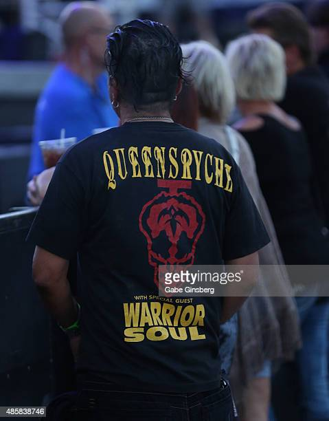 A fan wearing a Queensryche Tshirt attends the band's concert at the Downtown Las Vegas Events Center on August 29 2015 in Las Vegas Nevada