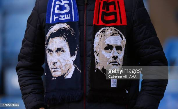 A fan wearing a scarf with the faces of Antonio Conte manager / head coach of Chelsea and Jose Mourinho the head coach / manager of Manchester United...