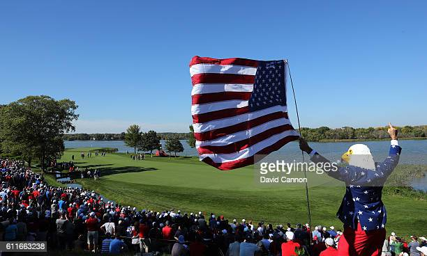 A fan wearing an eagle mask cheers during afternoon fourball matches of the 2016 Ryder Cup at Hazeltine National Golf Club on September 30 2016 in...