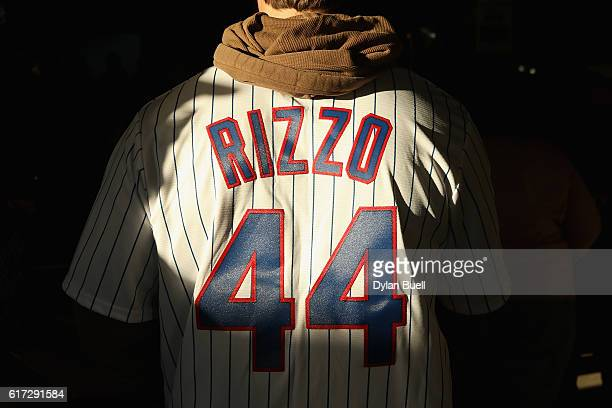 A fan wearing the jersey of Anthony Rizzo walks into Wrigley Field prior to game six of the National League Championship Series between the Chicago...