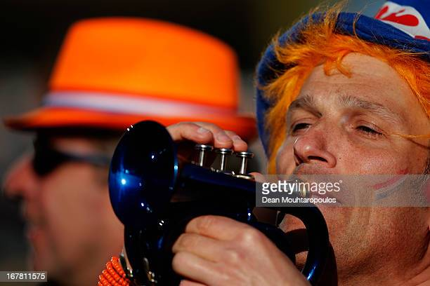 A fan wearing the national coulor of Orange shows their support as they wait to see King Willem Alexander Queen Maxima and their daughters Princess...