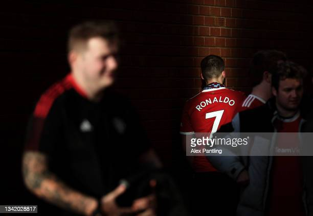 Fan wearing the shirt of Cristiano Ronaldo makes their way to the stadium prior to the Carabao Cup Third Round match between Manchester United and...