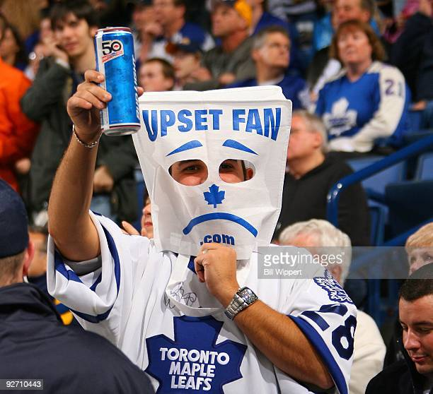 A fan wears a bag on his head showing his displeasure as the Toronto Maple Leafs play against the Buffalo Sabres on October 30 2009 at HSBC Arena in...