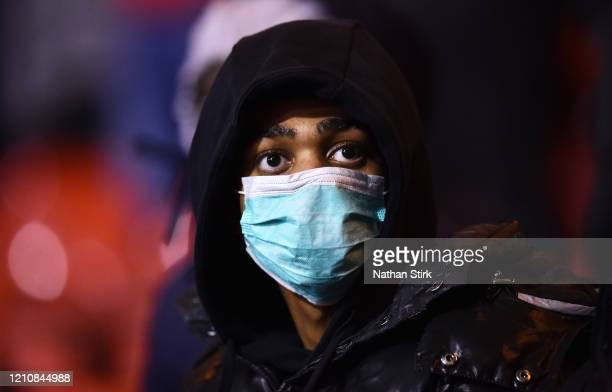 Fan wears a face mask as protection from Coronavirus during the Sky Bet Championship match between Nottingham Forest and Millwall at City Ground on...