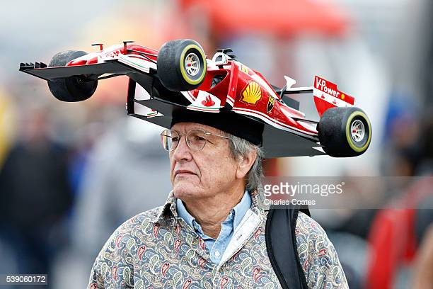 A fan wears a Ferrari F1 car hat during previews to the Canadian Formula One Grand Prix at Circuit Gilles Villeneuve on June 9 2016 in Montreal Canada