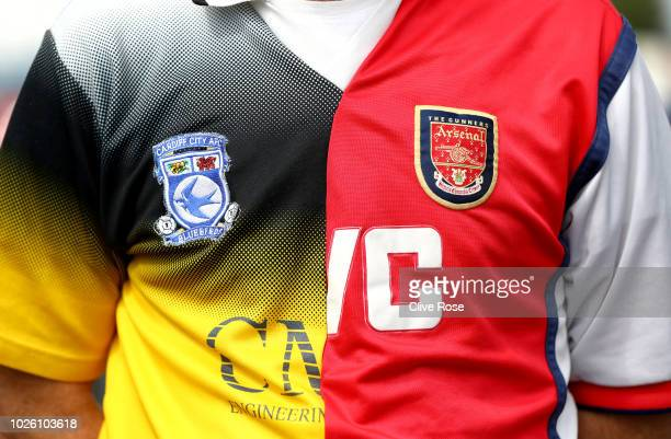 A fan wears a 'half and half shirt' prior to the Premier League match between Cardiff City and Arsenal FC at Cardiff City Stadium on September 2 2018...