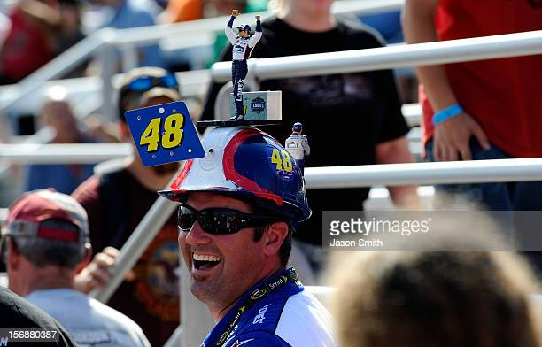 NASCAR fan wears a hat in support of Jimmie Johnson driver of the Lowe's Chevrolet during the Sylvania 300 at the New Hampshire Motor Speedway at New...