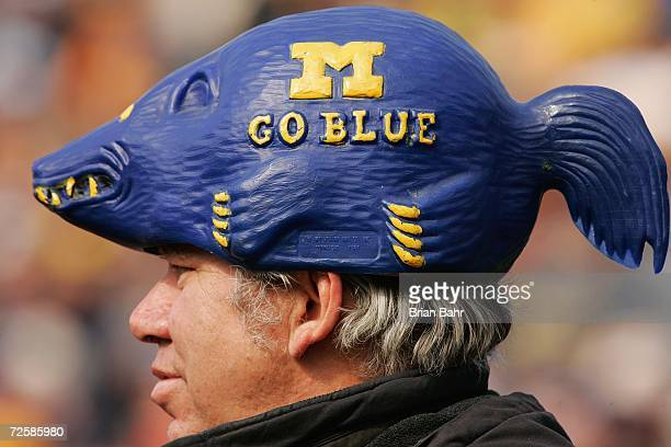 A fan wears a hat shaped like a wolverine during the NCAA football game between the Ball State Cardinals and the Michigan Wolverines on November 4...