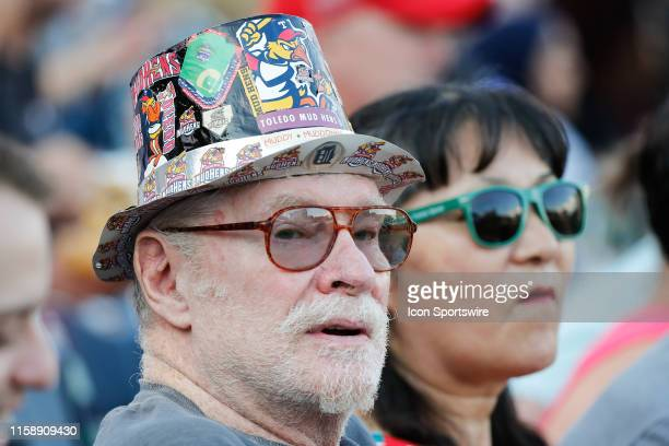 Fan wears a homemade Toledo Mud Hens hat during a regular season game between the Louisville Bats and the Toledo Mud Hens on July 30, 2019 at Fifth...