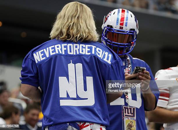 A fan wears a jersey in memory of 9/11 during the game between the Dallas Cowboys and New York Giants at ATT Stadium on September 11 2016 in...