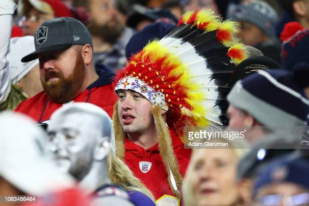 Fan wears a Native American headdress during a game between the Kansas City Chiefs and the New England Patriots at Gillette Stadium on October 14,...