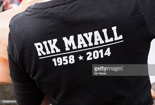 A fan wears a tshirt as a memorial bench for the late Rik Mayall is unveiled on November 14 2014 in London England