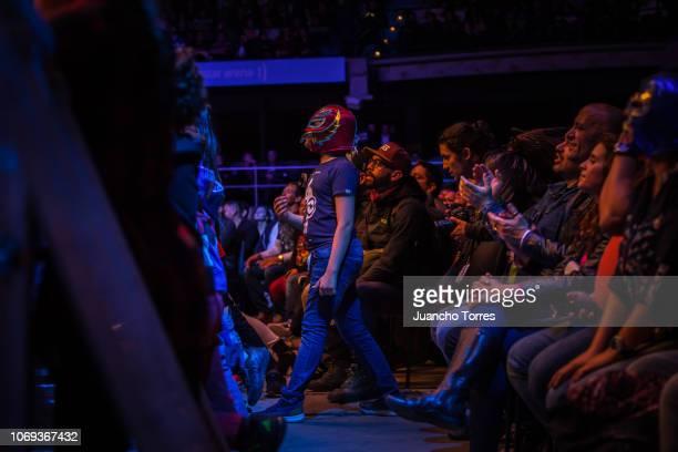 A fan wears a wrestling mask during an AAA World Wide Wrestling match on November 16 2018 in Bogota Colombia