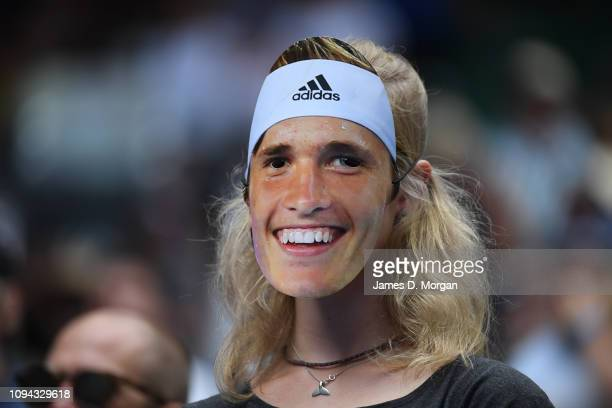 A fan wears an Alexander Zverev face mask after his victory against Aljaz Bedene of Slovakia during day two of the 2019 Australian Open at Melbourne...