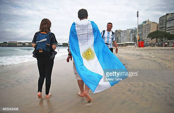 A fan wears an Argentine flag on Copacabana Beach ahead of their 2014 FIFA World Cup final match against Germany on July 11 2014 in Rio de Janeiro...