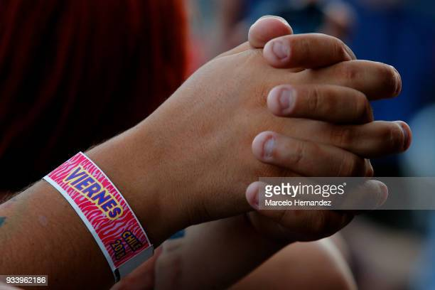 A fan wears an official bracelet during the first day of Lollapalooza Chile 2018 at Parque O'Higgins on March 16 2018 in Santiago Chile