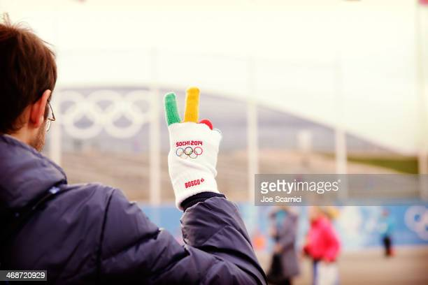A fan wears Olympic gloves in the Olympic Park on Day 4 of the 2014 Winter Olympics on February 11 2014 in Sochi Russia