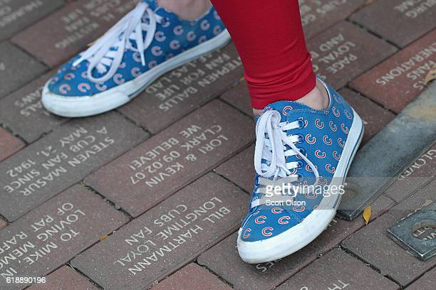 A fan wears shoes adorned with Chicago Cubs logos before Game Three of the 2016 World Series between the Chicago Cubs and the Cleveland Indians at...