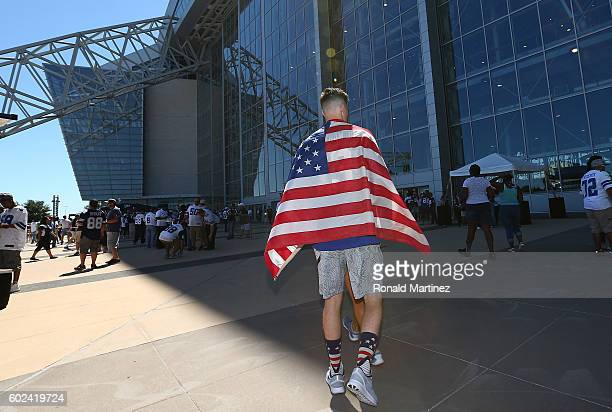 NFL fan wears the American flag before a game between the New York Giants and the Dallas Cowboys at ATT Stadium on September 11 2016 in Arlington...