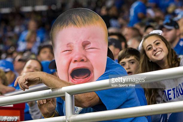A fan wheres an enlarged crying baby face during game action between the Arizona Cardinals and the Detroit Lions during a regular season game played...
