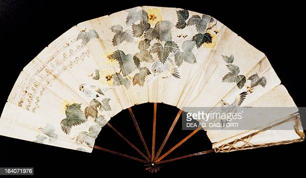 Fan which belonged to Yvonne Lerolle daughter of the painter Henry Lerolle with a dedication to Claude Debussy and musical notes from Pelleas et...