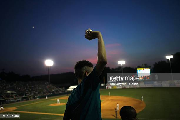 Fan with a fly ball during the New Britain Rock Cats Vs Binghamton Mets Minor League Baseball game at New Britain Stadium, New Britain, Connecticut,...