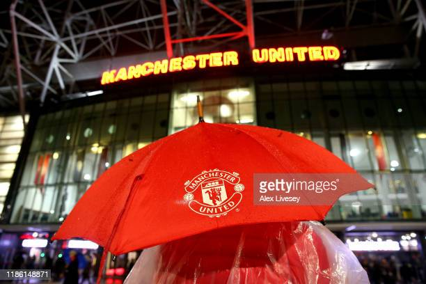 A fan with a Manchester United Umbrella stands outside the stadium prior to the UEFA Europa League group L match between Manchester United and...