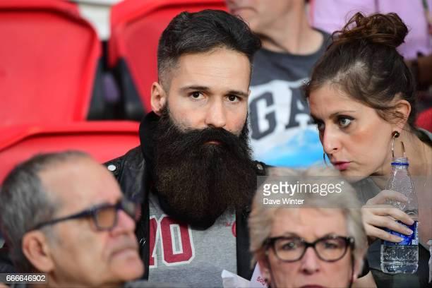 A PSG fan with a spectacular beard during the French Ligue 1 match between Paris Saint Germain PSG and En Avant Guingamp at Parc des Princes on April...