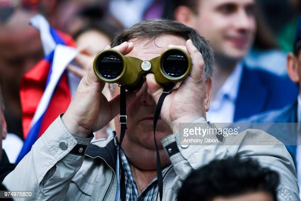 Fan with binoculars during the 2018 FIFA World Cup Russia group A match between Russia and Saudi Arabia at Luzhniki Stadium on June 14 2018 in Moscow...