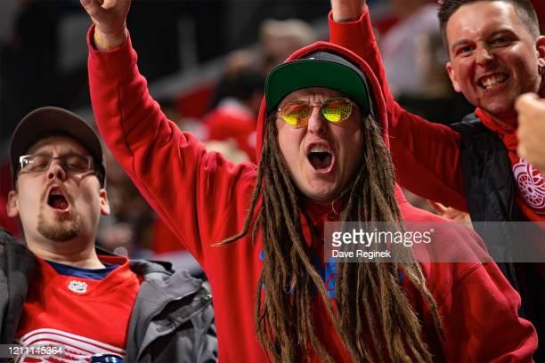A fan with dred locks has some fun during an NHL game between the Detroit Red Wings and the Chicago Blackhawks at Little Caesars Arena on March 6...
