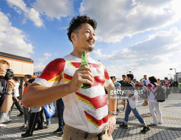 A fan with his body painted in the colors of the Japan rugby team's shirt is pictured in Chofu western Tokyo on Sept 20 ahead of the Rugby World Cup...