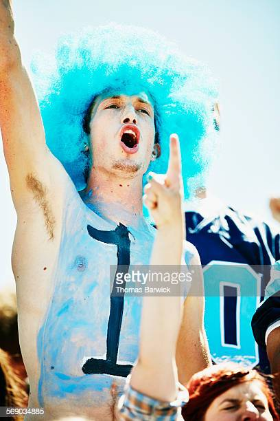 fan with number one painted on chest cheering - body paint stock pictures, royalty-free photos & images
