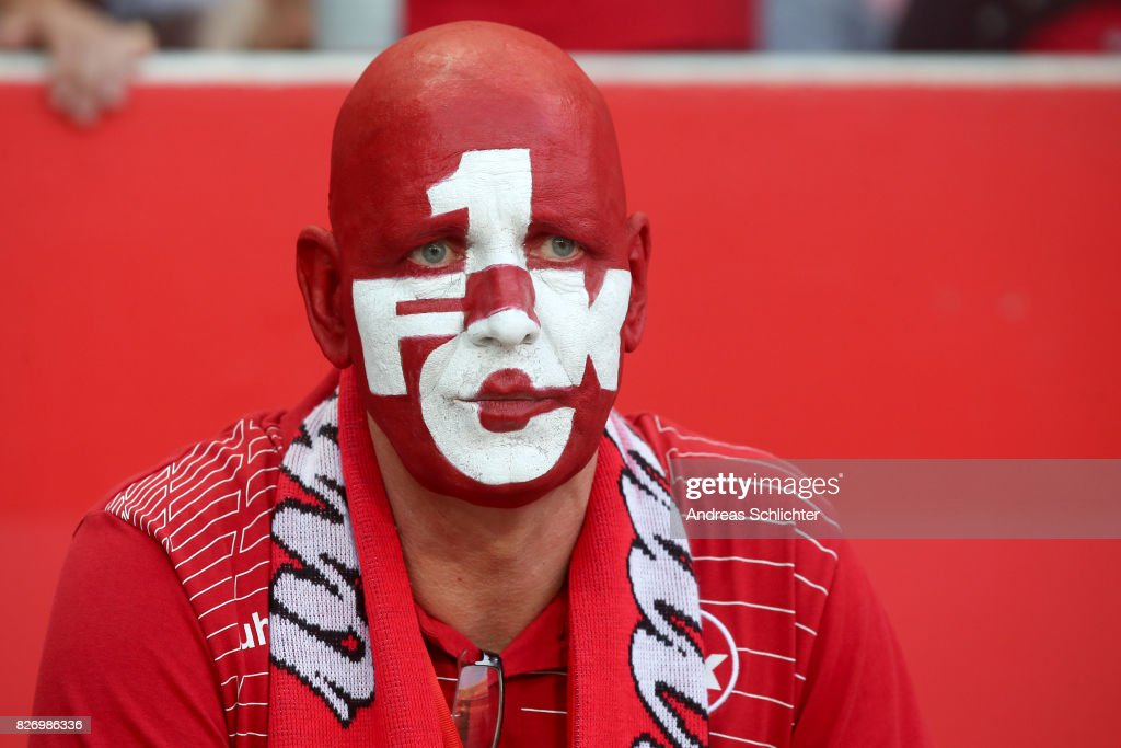 fan with painted face of Kaiserslautern during the Second Bundesliga match between 1. FC Kaiserslautern and SV Darmstadt 98 at Fritz-Walter-Stadion on August 4, 2017 in Kaiserslautern, Germany.