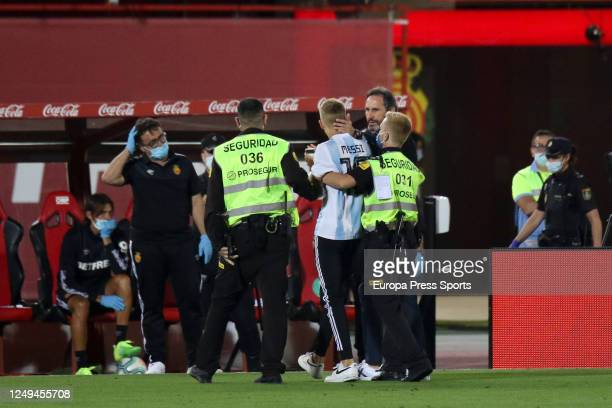 A fan with the Argentina shirt of Leo Messi jumps to the field and is taken out by the Security of the stadium during the spanish league LaLiga...